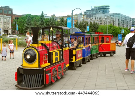 Montreal Quebec Canada 8 July 2016 Train riding fun for children in miniature locomotive at Old Port tourist attraction summer outdoor amusement area