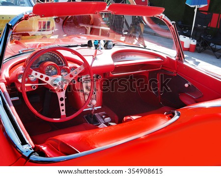 Montreal Quebec Canada - July 20 2014 - Vintage car exhibition Festival Just for Laughs . Red 1960 Corvette and Blue Belair chevrolet upholstery interior with racing steering guage speedometer