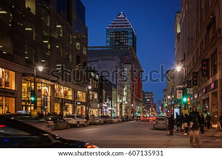 Montreal, Quebec, Canada - March 11, 2016: Evening in downtown Montreal city, early sunset. Image can have grain or noise when view at full resolution. Selective focus on central point