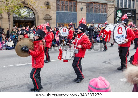 MONTREAL, QUEBEC, CANADA - NOVEMBER 21, 2015 :Children musicians in the 65th edition of the Santa Claus Parade Destination Centre-ville (Defile du Pere Noel) along Saint Catherine Street. - stock photo