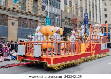 MONTREAL, QUEBEC, CANADA - NOVEMBER 21, 2015 : Cook and baker platform in the 65th edition of the Santa Claus Parade Destination Centre-ville (Defile du Pere Noel) along Saint Catherine Street. - stock photo