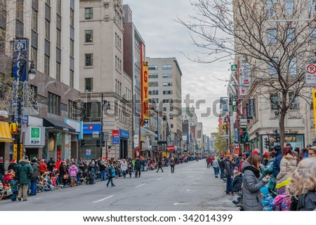 MONTREAL, QUEBEC, CANADA - NOVEMBER 21, 2015 : Crowded Saint Catherine Street before the 65th edition of the Santa Claus Parade Destination Centre-ville (Defile du Pere Noel) - stock photo