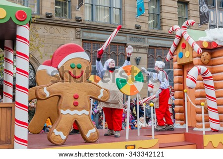 MONTREAL, QUEBEC, CANADA - NOVEMBER 21, 2015 : Ginger bread man platform in the 65th edition of the Santa Claus Parade Destination Centre-ville (Defile du Pere Noel) along Saint Catherine Street. - stock photo
