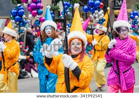 MONTREAL, QUEBEC, CANADA - NOVEMBER 21, 2015 : Girl Guides of Canada at the 65th edition of the Santa Claus Parade Destination Centre-ville (Defile du Pere Noel) along Saint Catherine Street. - stock photo