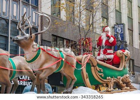 MONTREAL, QUEBEC, CANADA - NOVEMBER 21, 2015 : Santa Claus sleigh at the 65th edition of the Santa Claus Parade Destination Centre-ville (Defile du Pere Noel) along Saint Catherine Street. - stock photo