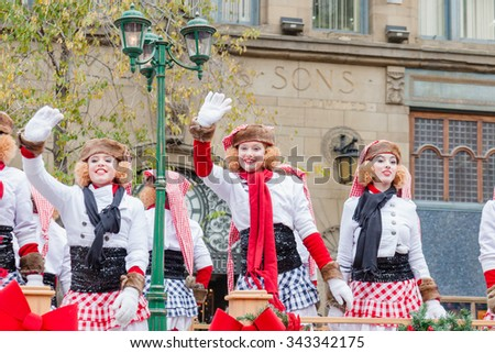 MONTREAL, QUEBEC, CANADA - NOVEMBER 21, 2015 : Women dancers platform in the 65th edition of the Santa Claus Parade Destination Centre-ville (Defile du Pere Noel) along Saint Catherine Street. - stock photo