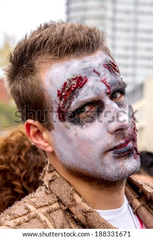 MONTREAL, QUEBEC, CANADA - OCTOBER 19: Zombies at the 2013 Montreal Zombie Walk, 19th of October 2013.  - stock photo