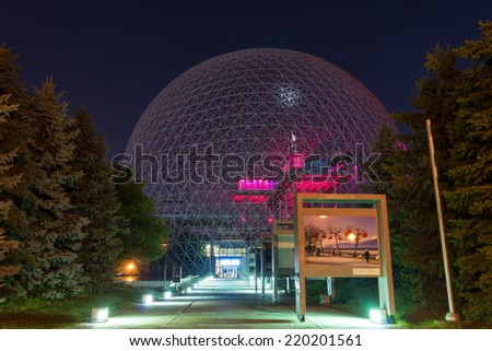 Montreal,Quebec,Canada-September 28-2014 Biosphere of Montreal at Night Red This structure was in 1967 the Pavilion from the United States has the Montreal International Exhibition.  - stock photo