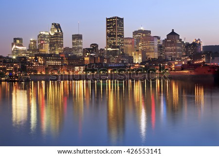 Montreal skyline at dusk and St Lawrence River, Quebec, Canada - stock photo