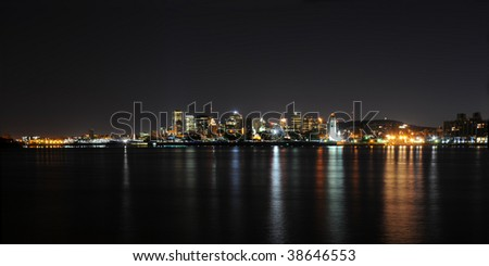 Montreal skyline at night from south Ste-Helene Island - stock photo