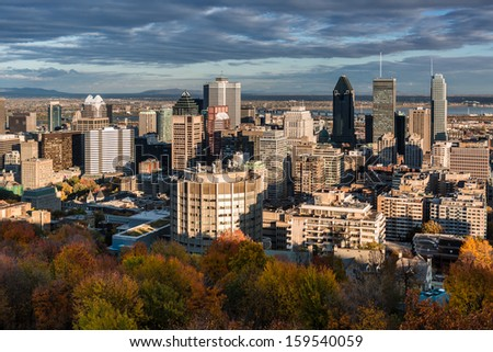 Montreal skyline viewed from the Mount Royal on a late afternoon. - stock photo