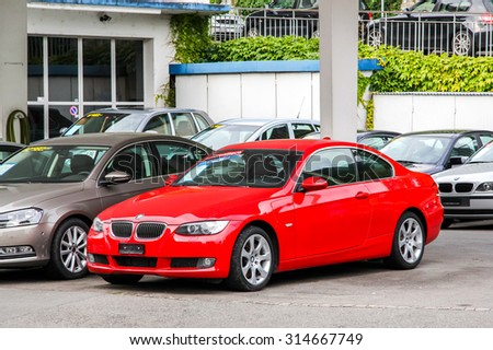 MONTREUX, SWITZERLAND - AUGUST 6, 2014: Motor car BMW E92 3-series at the used cars trade center. - stock photo