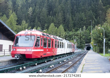 MONTROC, FRANCE - SEPTEMBER 02: Alpine tram at Montroc village station. The area is a stage of the popular Mont Blanc tour, which crosses France, Italy and Switzerland. September 02, 2014 in Montroc. - stock photo