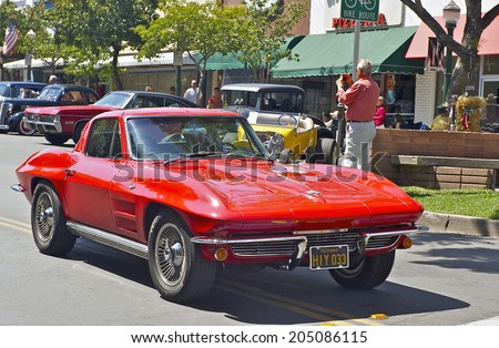 MONTROSE/CALIFORNIA - JULY 6, 2014: Classic Chevy Corvette as it departs the Montrose Hot Rod & Classic Car Show. July 6, 2014 Montrose, California USA - stock photo