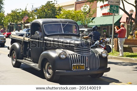 MONTROSE/CALIFORNIA - JULY 6, 2014: Classic 1941 Chevy Truck as it departs the Montrose Hot Rod & Classic Car Show. July 6, 2014 Montrose, California USA  - stock photo