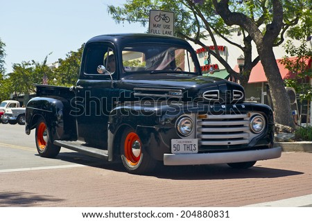 MONTROSE, CALIFORNIA - JULY 6, 2014: Classic Ford f100 as it departs the Montrose Hot Rod & Classic Car Show. July 6, 2014 Montrose, California USA - stock photo