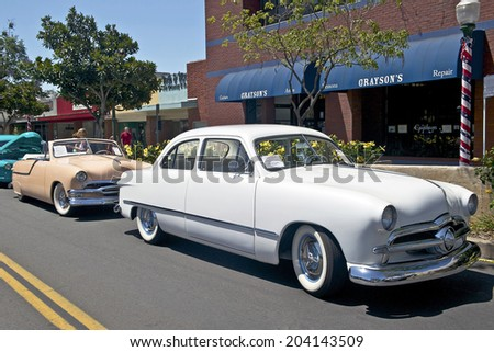 MONTROSE/CALIFORNIA - JULY 6, 2014: 1949 Ford (Lil' Darlin') and 1951 Ford Convertible owned by Sandy Norris at the Montrose Hot Rod & Classic Car Show. July 6, 2014 Montrose, California USA - stock photo