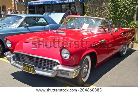 MONTROSE/CALIFORNIA - JULY 6, 2014: 1957 Ford Thunderbird owned by Elayne Rodrigues at the Montrose Hot Rod & Classic Car Show. July 6, 2014 Montrose, California USA  - stock photo