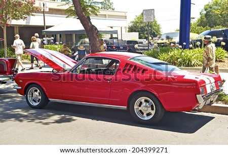 MONTROSE/CALIFORNIA - JULY 6, 2O14: 1962 Ford Mustang Fastback 2+2 owned by Nick Sfetko at the Montrose Hot Rod & Classic Car Show. July 6, 2014 Montrose, California USA - stock photo