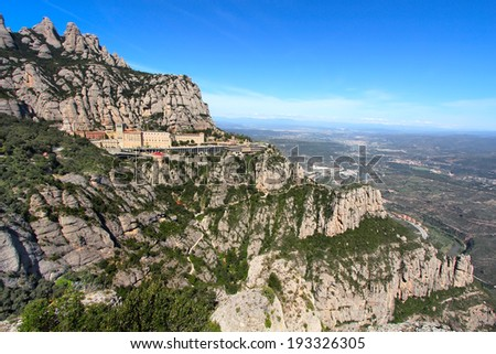 Montserrat Monastery high up in the mountains near Barcelona, Catalonia, Spain - stock photo