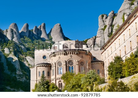 Montserrat Monastery is a beautiful Benedictine Abbey high up in the mountains near Barcelona, Spain - stock photo