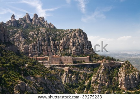 Montserrat Monastery is a spectacularly beautiful Benedictine Abbey high up in the mountains near Barcelona, Catalonia, Spain. - stock photo