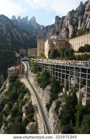 MONTSERRAT, SPAIN - OCTOBER 25, 2014: Every day, hundreds of people travel to the top of the mountain to visit Santa Maria de Montserrat abbey in Montserrat, Catalonia, Spain, Oct.25, 2014