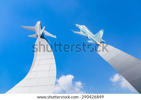 Monument Air force  Thailand on January 12, 2013 Monument of the Royal Thailand Air Force, Air plane take off on blue sky. - stock photo