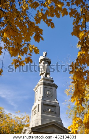 Monument and Autumn colors at the Charles River bank on Harvard University campus in Cambridge, MA, USA - stock photo