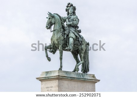 Monument by Louis XIV in front of Versailles Palace. Palace Versailles was a royal chateau. It was added to UNESCO list of World Heritage Sites. - stock photo
