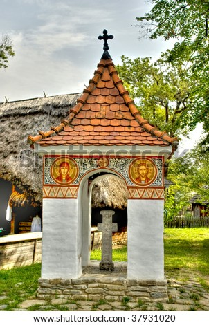 monument in wooden village in old Romanian style - stock photo