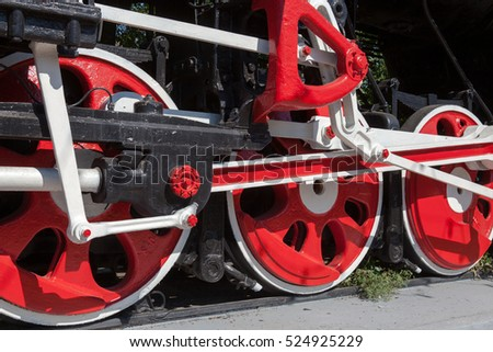 Monument locomotive at lelah with big red wheels.