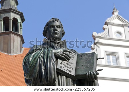 Monument of Martin Luther in Wittenberg, Germany. It was the first public monument of the reformer, designed 1821 by J. G. Schadow. Luther  was a monk and church reformer, the translator of the bible - stock photo