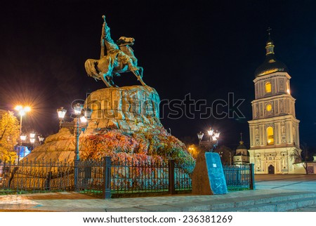 Monument to hetman of Ukraine Bogdan Khmelnitsky and Saint Sophia Cathedral on Sofia square in Kiev at night. Capital of Ukraine - Kyiv city. - stock photo