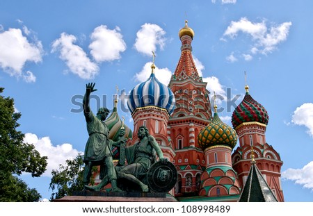 Monument to Minin and Pozharsky and St. Basil's Cathedral on the background of blue sky. Red Square. The Kremlin, Moscow - stock photo