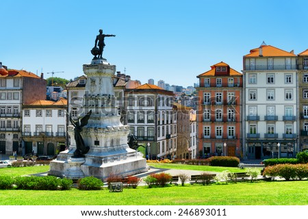 Monument to Prince Henry The Navigator, Infante Dom Henrique, and colorful facades of old houses in the centre of Porto, Portugal. Porto is one of the most popular tourist destinations in Europe. - stock photo