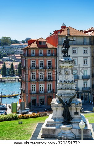 Monument to Prince Henry The Navigator, Infante Dom Henrique, and facades of old houses in the historic centre of Porto, Portugal. Porto is one of the most popular tourist destinations in Europe. - stock photo