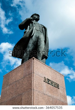 Monument to the leader of the proletariat Lenin against the sky. Monument of  Lenin stretching his hand - stock photo