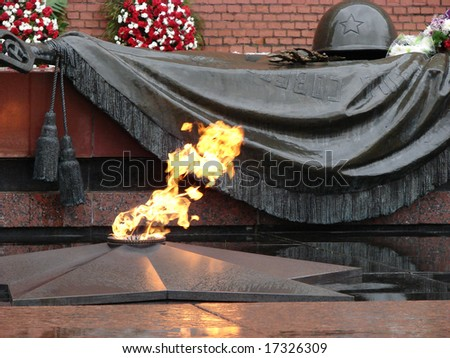 Monument to the unknown soldier, eternal fire, about the Kremlin wall, the Aleksandrovsky garden, Moscow. Red Square - stock photo