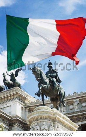 Monument to Victor-Emmanuel II (Monumento Nazionale a Vittorio Emanuele II) in Rome, Italy, against a fluttering national flag - stock photo