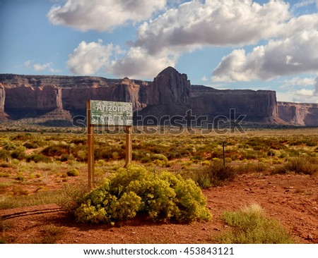 Monument Valley and the arizona state boundary border - stock photo