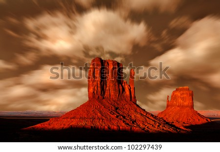 Monument Valley Arizona, The Red Rock Buttes, also called Mittens Under An Impressive Sky - stock photo