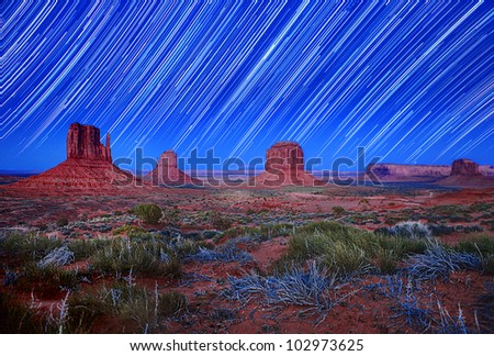 Monument Valley Arizona USA Star Trail Landscape Image. Image Has Slight Grain Due to Conditions. - stock photo