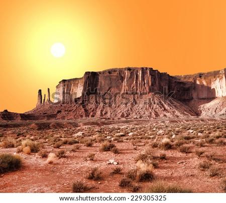 Monument Valley Arizona with evening warm skies - stock photo