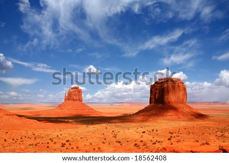Monument Valley Buttes With Cloud Cast Shade  Along the Valley - stock photo