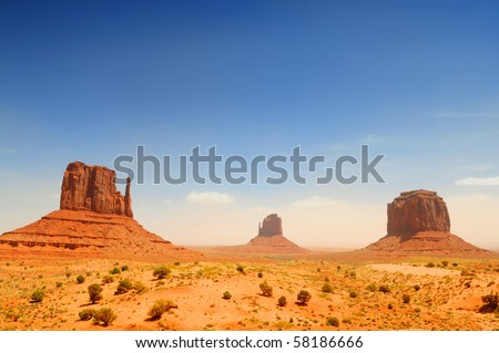 Monument Valley, famous movie landscape on sunny day - stock photo