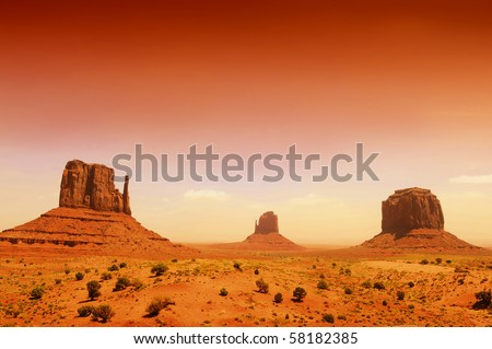 Monument Valley, famous movie landscape with red evening light - stock photo