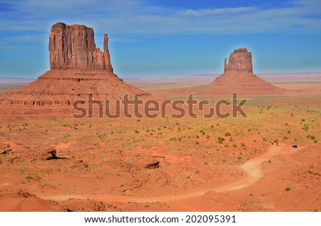 Monument Valley is a region of the Colorado Plateau characterized by a cluster of vast sandstone buttes above the valley floor. It is located on the Arizona-Utah state line, USA - stock photo