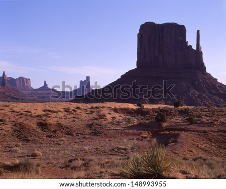 Monument Valley Navajo Tribal Park, Arizona, Utah./ Monument Valley/ A beautiful lowland basin created  millions of years ago. Now a popular vacation destination for visitors from  around the world.