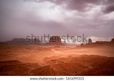 Monument Valley Navajo Tribal Park - Wind and Storm Clouds - Long exposure - stock photo